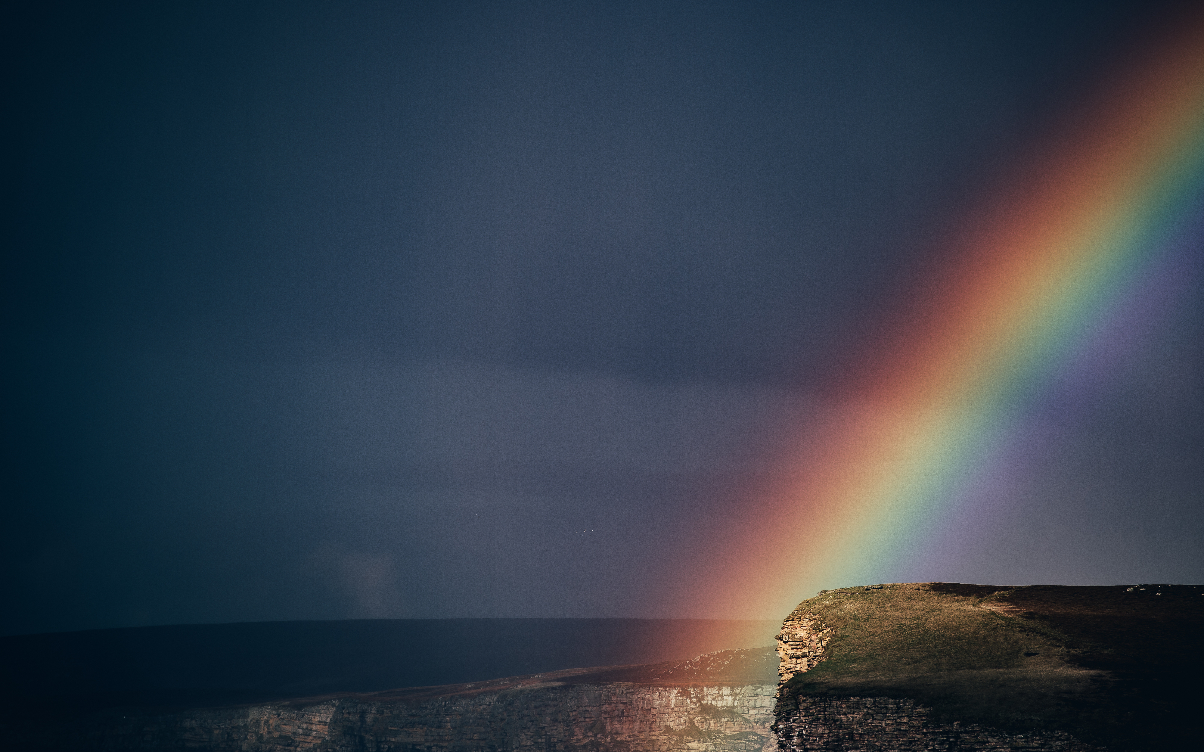 Rainbow over cliffs